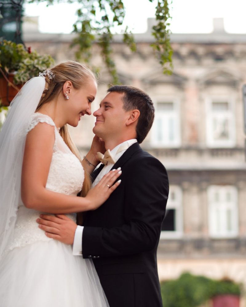 Thank you for everything. Low angle shot of a beautiful newlywed couple on the city background