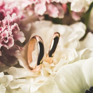 close up view of wedding rings in bridal bouquet